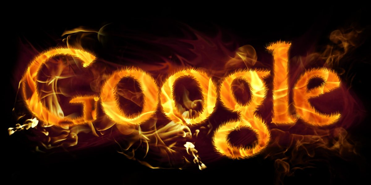 Google logo in burning flames.